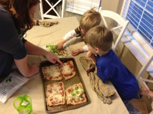 Make your own pizza night. The boys picked their veggies and sprinkled them on.